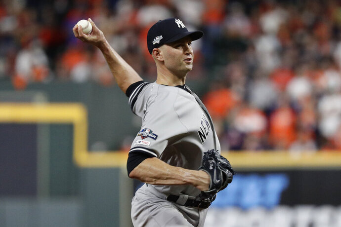 FILE - In this Oct. 13, 2019, file photo, New York Yankees pitcher J.A. Happ throws against the Houston Astros during the 11 inning in Game 2 of baseball's American League Championship Series in Houston. Happ is likely to be among the pitchers the Yankees use in Game 4, manager Aaron Boone said Monday, Oct. 14, 2019. Happ gave up a game-ending home run to Houston's Carlos Correa in Game 2. ( AP Photo/Eric Gay, File)