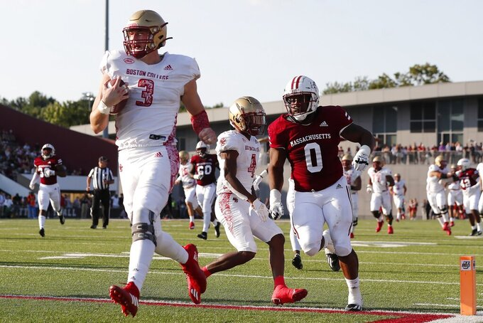 Boston College tight end Trae Barry (3) scores ahead of Massachusetts defensive lineman Avien Peah (0) during the second half of an NCAA college football game, Saturday, Sept. 11, 2021, in Amherst, Mass. (AP Photo/Michael Dwyer)