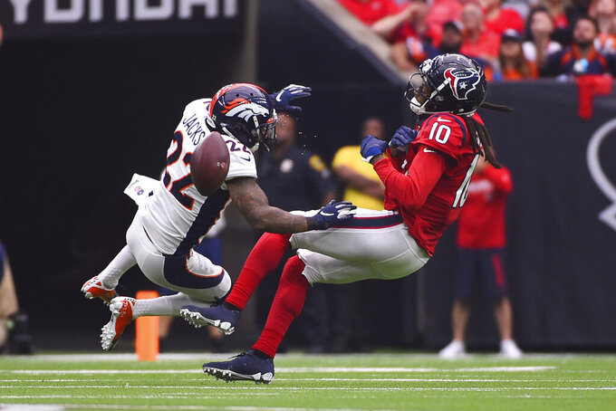 Denver Broncos strong safety Kareem Jackson (22) breaks up a pass intended for Houston Texans wide receiver DeAndre Hopkins (10) during the first half of an NFL football game Sunday, Dec. 8, 2019, in Houston. (AP Photo/Eric Christian Smith)