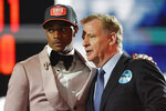 Alabama cornerback Patrick Surtain II, left, stands with NFL Commissioner Roger Goodell after the Denver Broncos selected Surtain with the ninth pick during the first round of the NFL football draft Thursday, April 29, 2021, in Cleveland. (AP Photo/Tony Dejak)