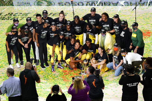 Members of the Seattle Storm organization celebrate after the team won basketball's WNBA Championship Tuesday, Oct. 6, 2020, in Bradenton, Fla. (AP Photo/Chris O'Meara)