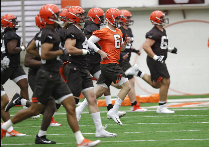 FILE - In this May 4, 2018, file photo, Cleveland Browns quarterback Baker Mayfield (6) runs a drill during rookie minicamp at the NFL football team's training camp facility in Berea, Ohio. A person familiar with the decision says the Browns will appear on HBO's