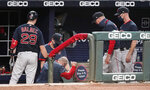 Boston Red Sox manager Ron Roenicke falls off the dugout's bench after a foul ball was hit by Boston Red Sox's Christian Vazquez (7) in the ninth inning of a baseball game against the Atlanta Braves, Saturday, Sept. 26, 2020, in Atlanta. (AP Photo/John Bazemore)