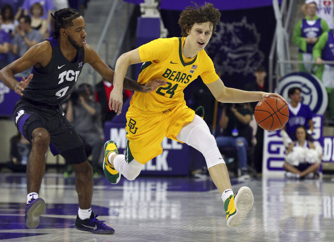 TCU guard PJ Fuller (4) guards Baylor guards Matthew Mayer (24) as he drives the ball during the first half of an NCAA college basketball game on Saturday, Feb. 29, 2020 in Fort Worth, Texas. (AP Photo/Richard W. Rodriguez)