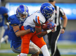 Air Force defensive back Milton Bugg III, left, drags down Boise State wide receiver John Hightower after he pulled in a pass in the first half of an NCAA college football game Saturday, Oct. 27, 2018, at Air Force Academy, Colo. (AP Photo/David Zalubowski)