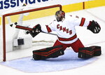Carolina Hurricanes goaltender Petr Mrazek (34) makes a diving stick save against the Boston Bruins during third period NHL Eastern Conference Stanley Cup playoff hockey action in Toronto on Wednesday, Aug. 19, 2020. (Nathan Denette/The Canadian Press via AP)