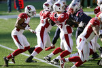 Arizona Cardinals running back Kenyan Drake, left, follows the blocking of his offensive line for a touchdown run in the first half of an NFL football game against the New England Patriots, Sunday, Nov. 29, 2020, in Foxborough, Mass. (AP Photo/Elise Amendola)
