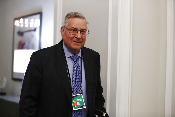FILE - In this May 22, 2019 file photo, Terry Pegula, arrives to the NFL football owners meeting in Key Biscayne, Fla.  Rather than fullfilling his promise of delivering Buffalo a championship, Pegula has instead overseen a team that's endured fitful starts and stops, gone through a revolving door of players and coaches, and is in the midst of a franchise-worst eight-year playoff drought, the NHL's longest active streak.  (AP Photo/Brynn Anderson, File )
