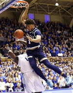 Georgia Tech's James Banks III (1) dunks over Duke's Zion Williamson (1) during the first half of an NCAA college basketball game in Durham, N.C., Saturday, Jan. 26, 2019. (AP Photo/Gerry Broome)