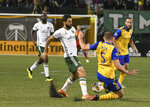 Portland Timbers' Diego Valeri (8) fights for possession against Colorado Rapids' Tommy Smith (5) during an MLS soccer match Saturday, Sept. 8, 2018, in Portland, Ore. (Kent Frasure/The Oregonian via AP)