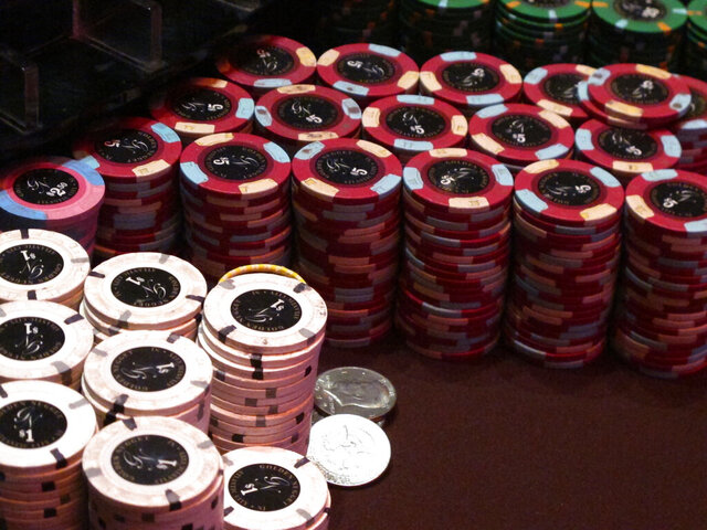This Feb. 22, 2019 photo shows stacks of gambling chips at the Golden Nugget casino in Atlantic City N.J. As of Monday, March 16, 2020, casinos in at least 15 states had shut down due to the coronavirus, including Atlantic City's nine casinos which were due to close at 8 p.m. (AP Photo/Wayne Parry)