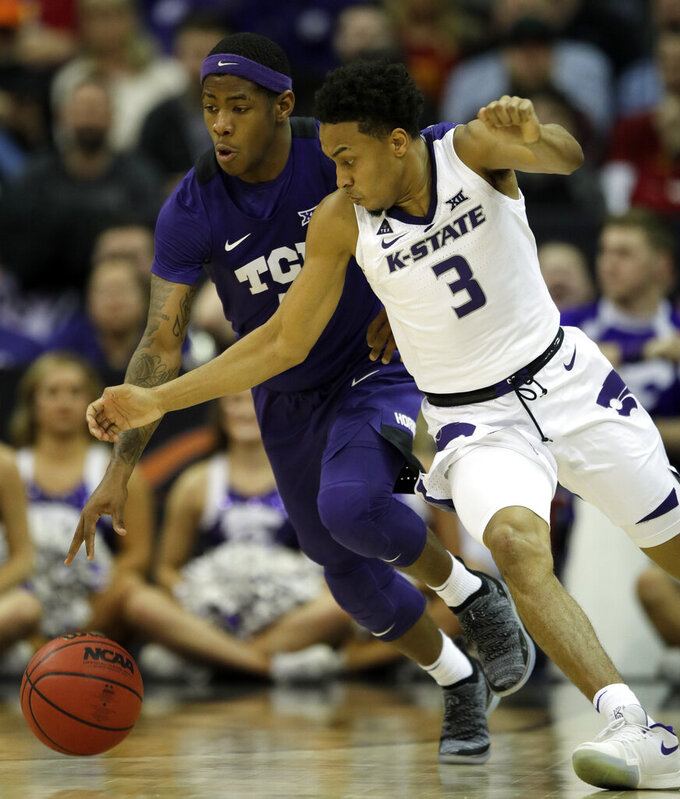 Kansas State guard Kamau Stokes (3) moves to steal the ball from TCU guard Kendric Davis, left, during the second half of an NCAA college basketball game in the quarterfinals of the Big 12 conference tournament in Kansas City, Mo., Thursday, March 14, 2019. Kansas State defeated TCU 70-61. (AP Photo/Orlin Wagner)