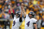 Baltimore Ravens kicker Justin Tucker (9) and Sam Koch (4) celebrate after Tucker made a field goal to defeat the Pittsburgh Steelers in overtime of an NFL football game, Sunday, Oct. 6, 2019, in Pittsburgh. The Ravens won 26-23. (AP Photo/Don Wright)
