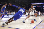 Seton Hall guard Myles Cale (22) and Villanova guard Phil Booth (5) compete for a loose ball during the second half of an NCAA college basketball game in the championship of the Big East Conference tournament, Saturday, March 16, 2019, in New York. Villanova won 74-72. (AP Photo/Julio Cortez)