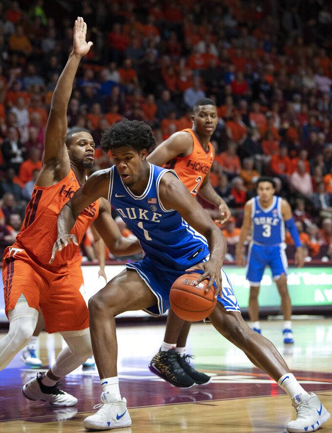 Duke center Vernon Carey Jr. (1) drives against Virginia Tech forward P.J. Horne, left, during the first half of an NCAA college basketball game Friday, Dec. 6, 2019, in Blacksburg, Va. (AP Photo/Don Petersen)