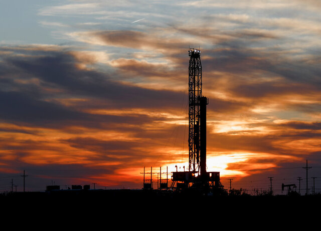 FILE - In this April 17, 2020, file photo, an oil rig stands against the setting sun in Midland, Texas. Texas regulators are relaxing rules about where companies can store oil underground, raising concern among environmentalists about potential groundwater contamination and other dangers. (Odessa American/Eli Hartman, File)