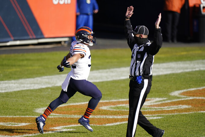 Chicago Bears' David Montgomery (32) celebrates after a running for a touchdown during the first half of an NFL football game against the Houston Texans, Sunday, Dec. 13, 2020, in Chicago. (AP Photo/Nam Y. Huh)