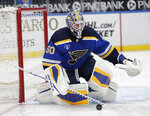 St. Louis Blues goaltender Jordan Binnington deflects a shot during the first period of the team's NHL hockey game against the Minnesota Wild, Thursday, May 13, 2021 in St. Louis. (AP Photo/Tom Gannam)