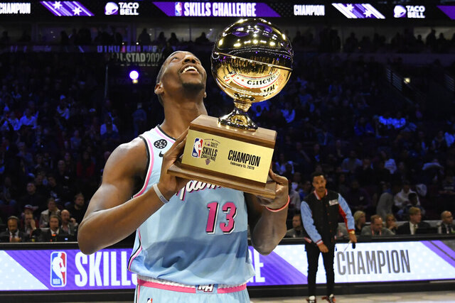 Miami Heat's Bam Adebayo holds the trophy after winning NBA basketball's All-Star Skills Challenge, Saturday, Feb. 15, 2020, in Chicago. (AP Photo/David Banks)