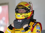 Michael McDowell adjusts his helmet before a practice session for the NASCAR Daytona 500 auto race at Daytona International Speedway, Friday, Feb. 15, 2019, in Daytona Beach, Fla. (AP Photo/John Raoux)