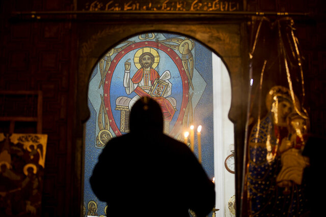 FILE - In this Jan. 6, 2018 file photo, a priest leads prayers prior to Christmas Eve Mass at the Virgin Mary church, in Cairo, Egypt. Egypt's highest court Wednesday, July 1, 2020 upheld a death sentence for a former monk convicted of killing an abbot in a desert monastery north of Cairo in 2018. (AP Photo/Amr Nabil, File)