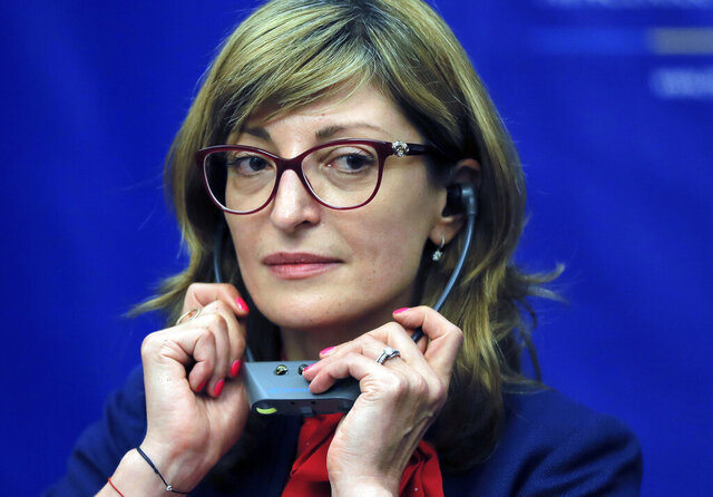 FILE - In this Wednesday, June 7, 2017 file photo, Bulgaria's Foreign Minister Ekaterina Zaharieva adjusts her headphones in Bucharest, Romania. North Macedonia, kept out of the European Union for years by a dispute with Greece, hit yet another hurdle this week when Bulgaria blocked its progress toward membership. The government in Sofia wants North Macedonia to recognize that its language has Bulgarian roots and to stamp out what it says is anti-Bulgarian rhetoric. Foreign Minister Zaharieva said it withheld its consent because North Macedonia is not observing a 2017 friendship treaty. (AP Photo/Vadim Ghirda, file)