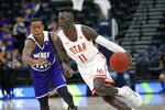 Utah guard Both Gach (11) drives around Weber State guard KJ Cunningham, rear, in the second half during an NCAA college basketball game Saturday, Dec. 14, 2019, in Salt Lake City. (AP Photo/Rick Bowmer)