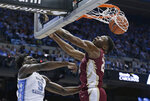 North Carolina's Nassir Little, left, throws down a dunk against Florida State's Mfiondu Kabengele during the first half of an NCAA college basketball game in Chapel Hill, N.C., Saturday, Feb. 23, 2019. (AP Photo/Gerry Broome)