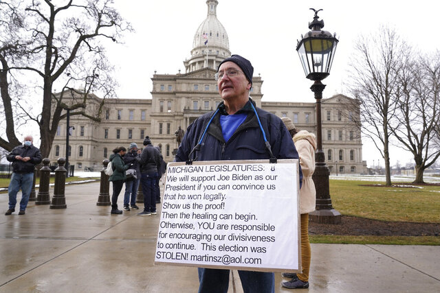 Martin Szelag stands outside the state capitol in Lansing, Mich., Sunday, Jan. 17, 2021. (AP Photo/Paul Sancya)