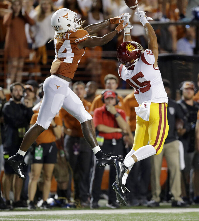 FILE - In this Sept. 15, 2018 file photo, Southern California safety Talanoa Hufanga (15) breaks up a pass intended for Texas Longhorns wide receiver Lil'Jordan Humphrey (84) during the first half of an NCAA college football game in Austin, Texas. XXXX (AP Photo/Eric Gay, File)