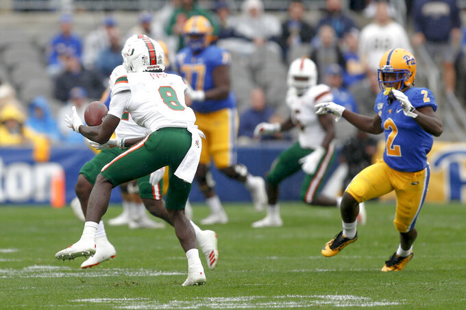 Miami cornerback DJ Ivey (8) intercepts a pass as Pittsburgh wide receiver Maurice Ffrench (2) pursues during the first half of an NCAA college football game, Saturday, Oct. 26, 2019, in Pittsburgh. (AP Photo/Keith Srakocic)