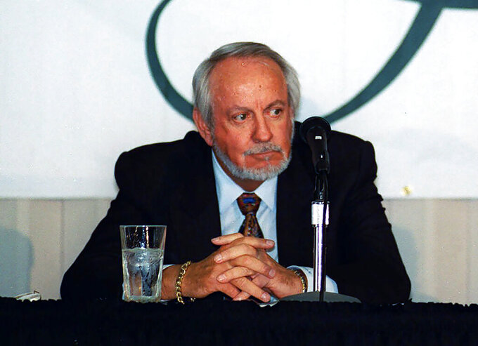 FILE - This May 6, 1999 file photo shows Hollywood Park Inc. CEO R.D. Hubbard listening during a news conference at the Hollywood Park Casino in Inglewood, Calif. Hubbard, who bred, owned and raced thoroughbred and quarter horses, and was an influential executive in the racing industry, has died. He was 84. Hubbard died Wednesday, April 29, 2020 at home with his wife Joan Dale at his side in Palm Desert, about 115 miles east of Los Angeles, according to Shaun Hubbard. His grandson told The Associated Press that he had been in declining health. (AP Photo/ Damian Dovarganes, file)