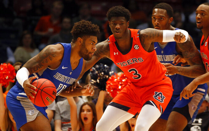 Saint Louis forward Hasahn French (11) dribbles around Auburn forward Danjel Purifoy (3) during the second half of an NCAA college basketball game Saturday, Dec. 14, 2019, in Birmingham, Ala. (AP Photo/Butch Dill)