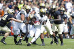 Vanderbilt running back Ke'Shawn Vaughn (5) Runs aways from Purdue linebacker Ben Holt (44) during the first half of an NCAA college football game in West Lafayette, Ind., Saturday, Sept. 7, 2019. (AP Photo/Michael Conroy)