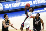 Mississippi's Jarkel Joiner (24) shoots over South Carolina's Trey Anderson, left, and Tre-Vaughn Minott (50) in the first half of an NCAA college basketball game in the Southeastern Conference Tournament Thursday, March 11, 2021, in Nashville, Tenn. (AP Photo/Mark Humphrey)