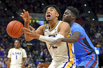 LSU forward Trendon Watford (2) loses the handle of the ball as he's fouled by Mississippi forward Khadim Sy, right, in the first half of an NCAA college basketball game, Saturday, Feb. 1, 2020, in Baton Rouge, La. (AP Photo/Bill Feig)