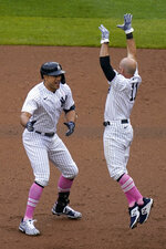 New York Yankees' Giancarlo Stanton, left, celebrates his walkoff single with Brett Gardner during the ninth inning of a baseball game against the Washington Nationals at Yankee Stadium, Sunday, May 9, 2021, in New York. (AP Photo/Seth Wenig)