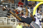Texas Tech's Trey Cleveland (85) misses a catch around TCU's Tre'Vius Hodges-Tomlinson (1) during the second half of an NCAA college football game against TCU, Saturday, Oct. 9, 2021, in Lubbock, Texas. (AP Photo/Brad Tollefson)