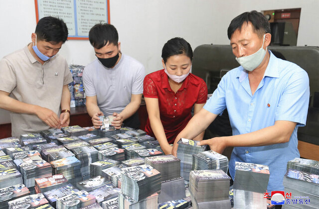 FILE - This file photo provided on June 20, 2020, by the North Korean government shows North Koreans prepare anti-South Korea propaganda leaflets in North Korea. South Korea on Monday, June 22, 2020 urged North Korea to scrap a plan to launch propaganda leaflets across the border, after the North said it's ready to float more than 10 million leaflets in what would be the largest such physiological campaign against its southern rival. Independent journalists were not given access to cover the event depicted in this image distributed by the North Korean government. The content of this image is as provided and cannot be independently verified. (Korean Central News Agency/Korea News Service via AP, File)