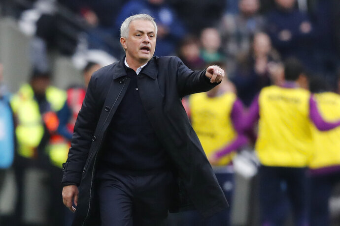 Tottenham's manager Jose Mourinho calls out to his players during the English Premier League soccer match between West Ham and Tottenham, at London stadium, in London, Saturday, Nov. 23, 2019.(AP Photo/Frank Augstein)