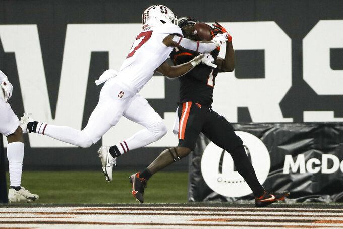 Oregon State wide receiver Tyjon Lindsey (1) outruns Stanford cornerback Kyu Blu Kelly (17) to catch a pass in the end zone for a touchdown during the second half of an NCAA college football game in Corvallis, Ore., Saturday, Dec. 12, 2020. Stanford won 27-24. (AP Photo/Amanda Loman)