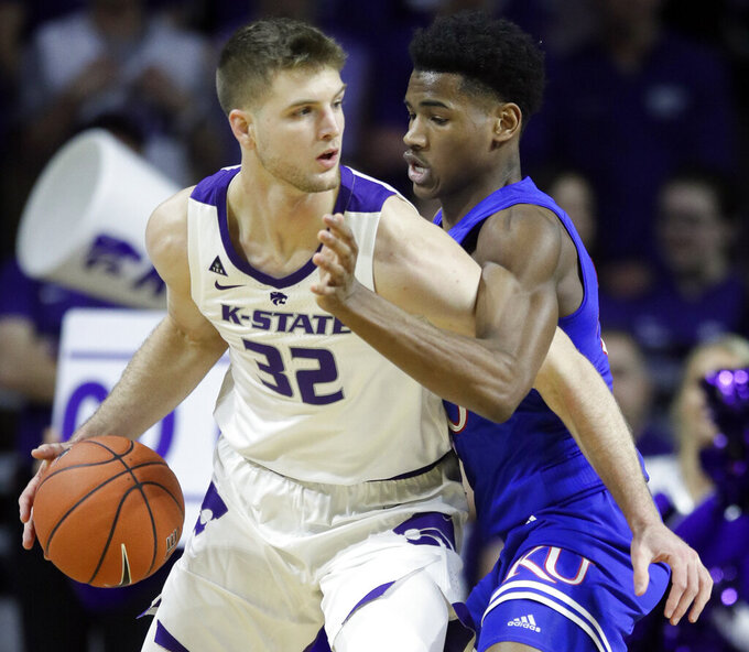 Kansas State forward Dean Wade (32) is covered by Kansas guard Ochai Agbaji, right, during the first half of an NCAA college basketball game in Manhattan, Kan., Tuesday, Feb. 5, 2019. (AP Photo/Orlin Wagner)