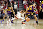 LSU defenders Marlon Taylor (14) and Trendon Watford (2) try to steal the ball from Arkansas forward Jimmy Whitt Jr. (33) during the second half of an NCAA college basketball game Wednesday, March 4, 2020, in Fayetteville, Ark. (AP Photo/Michael Woods)