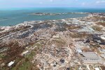 In this Sept. 4, 2019 photo, the destruction caused by Hurricane Dorian is seen from the air, in Marsh Harbor, Abaco Island, Bahamas. The death toll from Hurricane Dorian has climbed to 20. Bahamian Health Minister Duane Sands released the figure Wednesday evening and warned that more fatalities were likely. (AP Photo/Gonzalo Gaudenzi)