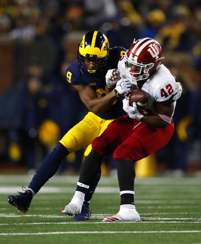 Indiana defensive back Marcelino Ball (42) intercepts a pass intended for Michigan wide receiver Donovan Peoples-Jones (9) in the second half of an NCAA college football game in Ann Arbor, Mich., Saturday, Nov. 17, 2018. (AP Photo/Paul Sancya)