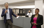 Grant Moise, left, The Dallas Morning News publisher, introduces Katrice Hardy as The News' executive editor, to the newsroom on Wednesday, July 21, 2021, in Dallas, Texas. Hardy, who also will be the first woman to hold the top job at the Dallas newsroom, will take up her duties next month. (Irwin Thompson/The Dallas Morning News via AP)