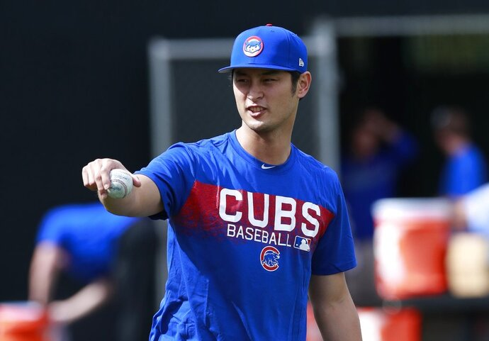 Chicago Cubs starting pitcher Yu Darvish takes a break from warmup pitches at the team's spring training baseball facility Tuesday, Feb. 13, 2018, in Mesa, Ariz. Darvish signed a $126 million, six-year contract over the weekend. (AP Photo/Carlos Osorio)