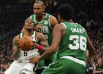 Milwaukee Bucks' Eric Bledsoe tries to drive past Boston Celtics' Al Horford and Marcus Smart during the first half of Game 5 of a second round NBA basketball playoff series Wednesday, May 8, 2019, in Milwaukee. (AP Photo/Morry Gash)
