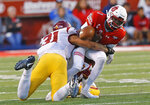 Utah quarterback Tyler Huntley (1) fumbles the ball after being tackled by Southern California linebacker Hunter Echols (31) during the first half of an NCAA college football game Saturday, Oct. 20, 2018, in Salt Lake City. (AP Photo/Rick Bowmer)