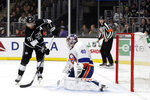 Los Angeles Kings' Jeff Carter, left, scores past New York Islanders goaltender Semyon Varlamov (40) during the second period of an NHL hockey game Wednesday, Nov. 27, 2019, in Los Angeles. (AP Photo/Marcio Jose Sanchez)